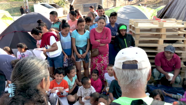 """american volunteer's during class at """"the sidewalk school"""" for immigrant children at a squalid """"remain in mexico"""" camp for asylum seekers on december... - mexican american stock videos & royalty-free footage"""
