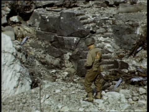 american war correspondents examining destroyed german pillboxes fortifications defensive emplacements / france - 礎石点の映像素材/bロール