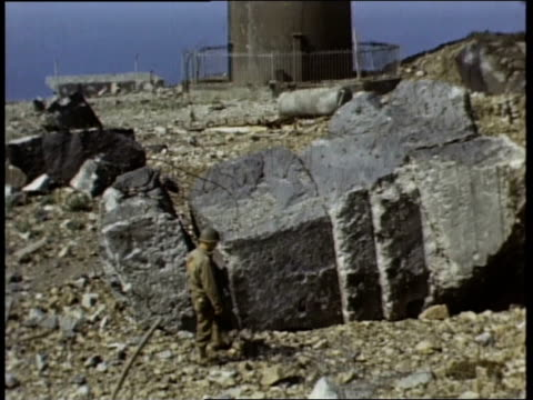 american war correspondents examining destroyed german pillboxes fortifications defensive emplacements / france - harassment stock videos & royalty-free footage