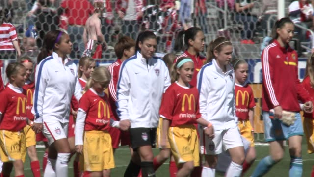 us american women play soccer / football against chinese women's team - women's football stock videos & royalty-free footage