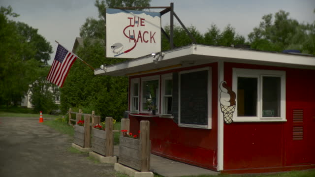 ws americana roadside snack bar with american flag, man getting out of pick-up truck and walking / stowe, vermont, usa   - roadside stock videos and b-roll footage