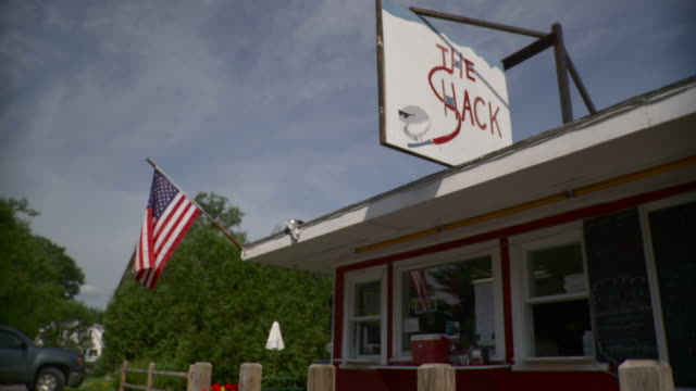 ws  americana roadside snack bar with american flag / stowe, vermont, usa   - stowe vermont stock videos & royalty-free footage