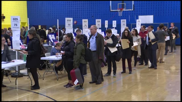 vídeos de stock, filmes e b-roll de americans across the u.s. are descending on polling stations in droves tuesday for this year's midterm elections.most voting locations began opening... - 2018