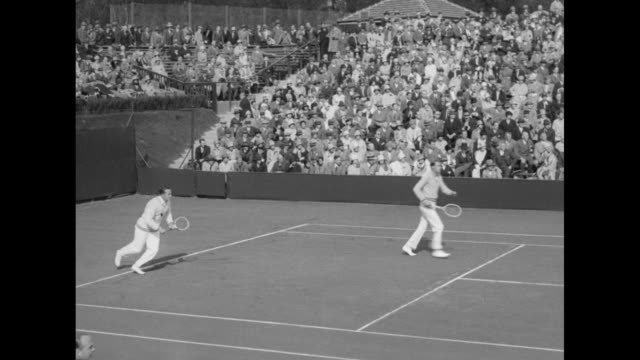 americans bill tilden, vincent richards, norris williams, bill johnson at play during men's doubles match at forest hills, new york, during the davis... - davis cup stock-videos und b-roll-filmmaterial