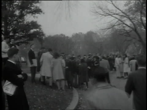 americans gather in prayer for the assassinated president kennedy as the white house flag flies at half mast. - john f. kennedy us president stock videos and b-roll footage