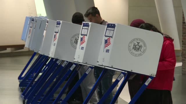 americans head to the polls at the brooklyn museum polling station in new york for midterm elections with president donald trump's republican party... - afp stock videos & royalty-free footage