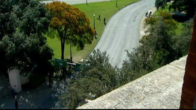 americans mark 50th anniversary of john f kennedy assassination int window view from window of road below cross marked on road hugh aynesworth... - attentat auf john f. kennedy stock-videos und b-roll-filmmaterial