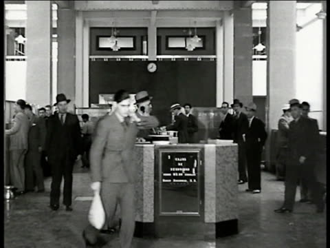 americans working in stock exchange at desk on phone one carrying bag cu panel w/ city names numbers cu panel 'paris londres nueva york' currency... - paris stock exchange stock videos & royalty-free footage