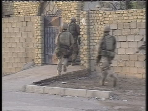american-soldiers break down a gate to enter a building in iraq. - (war or terrorism or election or government or illness or news event or speech or politics or politician or conflict or military or extreme weather or business or economy) and not usa stock videos & royalty-free footage