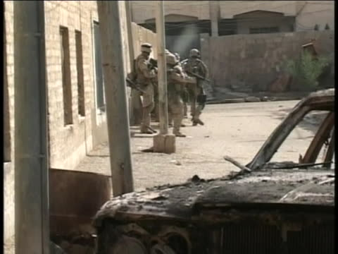 american-soldiers on foot-patrol near a burned-out car in iraq. - (war or terrorism or election or government or illness or news event or speech or politics or politician or conflict or military or extreme weather or business or economy) and not usa stock videos & royalty-free footage
