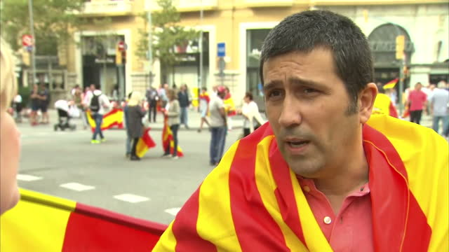Amid tensions with the Spanish region of Catalonia Spain celebrated its National Day with a military parade in Madrid In Barcelona pro and antiunity...