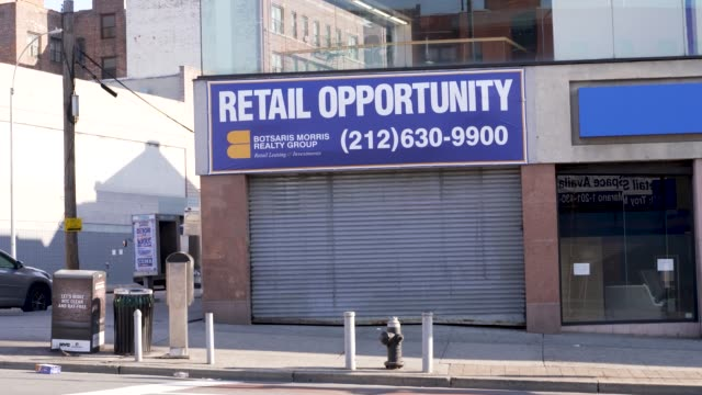 amid the outbreak of the coronavirus disease , non-essential stores have closed per order of the ny governor. store closures in east fordham road in... - non urban scene stock-videos und b-roll-filmmaterial