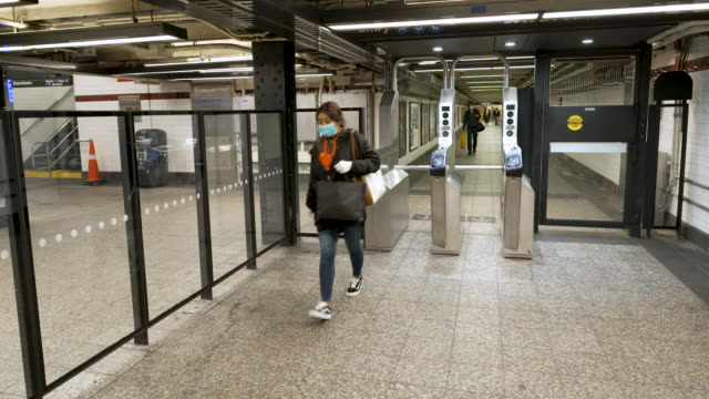 amid the outbreak of the coronavirus disease , penn station 34th street subway transportation hub has few commuters during the busy mid afternoon... - new york city penn station stock videos & royalty-free footage