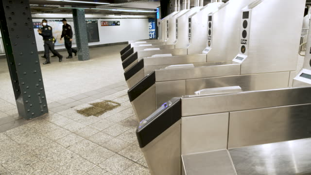 amid the outbreak of the coronavirus disease , penn station 34th street subway transportation hub has few commuters during the busy mid afternoon... - 34th street stock videos & royalty-free footage
