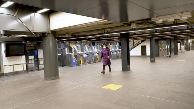 amid the outbreak of the coronavirus disease , penn station 34th street subway transportation hub has few commuters during the busy midafternoon... - 34th street stock videos & royalty-free footage