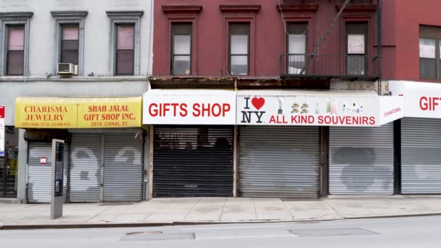 amid the outbreak of the coronavirus disease , per order of the ny governor non-essential stores remain closed in chinatown, downtown manhattan, new... - non urban scene stock-videos und b-roll-filmmaterial