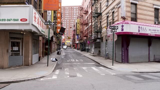 amid the outbreak of the coronavirus disease , per order of the ny governor non-essential stores remain closed in chinatown, downtown manhattan, new... - chinatown stock videos & royalty-free footage