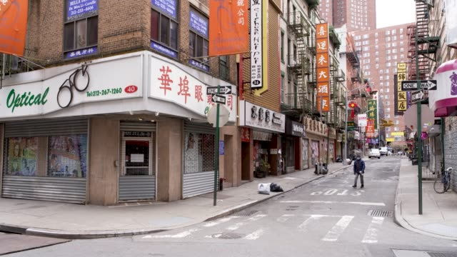 amid the outbreak of the coronavirus disease per order of the ny governor nonessential stores remain closed in chinatown downtown manhattan new york... - chinatown stock videos & royalty-free footage
