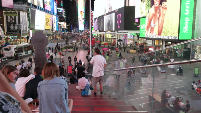 stockvideo's en b-roll-footage met amid the outbreak of the coronavirus disease the times square red steps observatory deck above the theatre development fund closed because of social... - elektronisch reclamebord