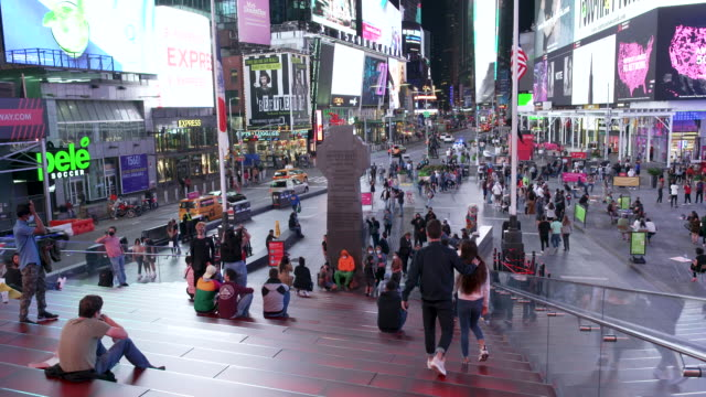 vídeos de stock e filmes b-roll de amid the outbreak of the coronavirus disease the times square red steps observatory deck above the theatre development fund closed because of social... - painel publicitário eletrónico