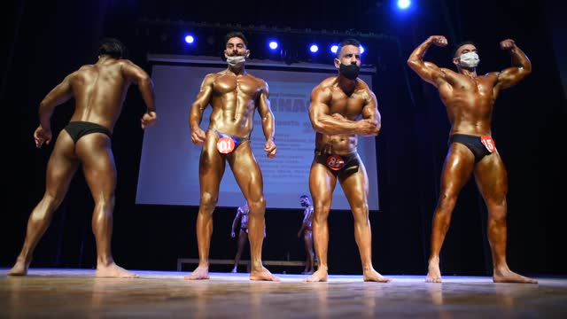 amid the pandemic bodybuilders strike a pose during the mr. srinagar bodybuilding competition organized by jammu and kashmir bodybuilding... - body building stock videos & royalty-free footage
