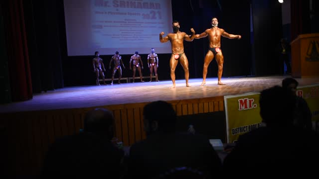 amid the pandemic bodybuilders strike a pose during the mr. srinagar bodybuilding competition organized by jammu and kashmir bodybuilding... - world sports championship stock videos & royalty-free footage