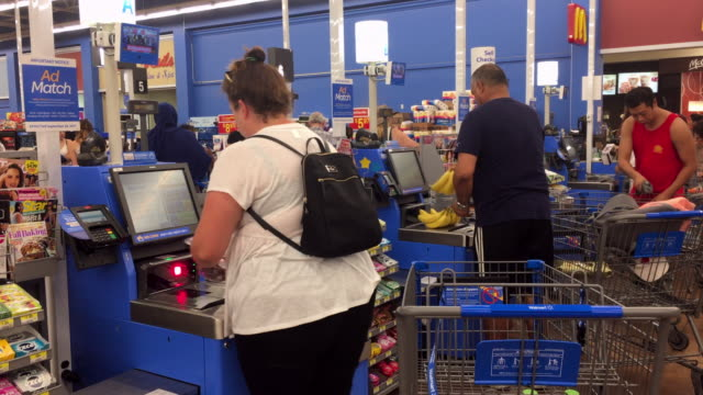 amid the upcoming minimum wage hike in ontario walmart and other business are starting to roll out test and implement selfcheckout systems to reduce... - self service stock videos & royalty-free footage