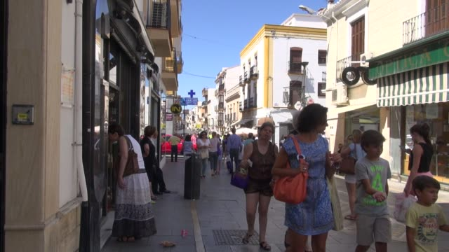 amidst crowd of shoppers filling the street before the afternoon 'siesta' when virtually all the stores close calle espinall is one of the best... - napping stock videos & royalty-free footage