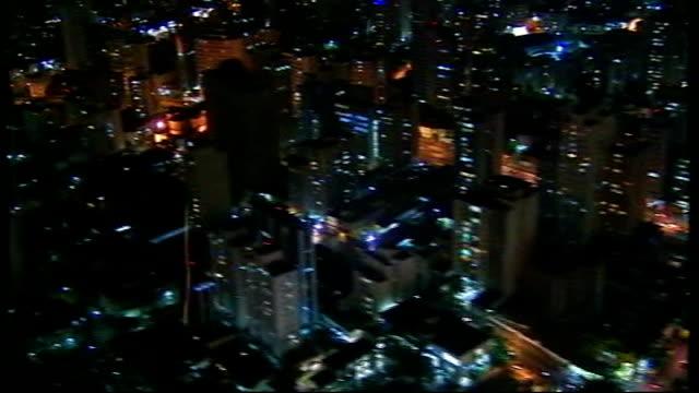vídeos de stock, filmes e b-roll de amilcare davello jnr interview sot ext / night air views / aerials city centre lights seen from amilcare davello's helicopter cutaways amilcare... - plasma matéria