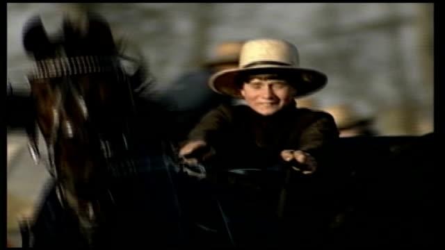 vídeos de stock, filmes e b-roll de gunman named as charles carl roberts young amish man along driving horse and cart general views of amish perople along in horse and buggies - amish