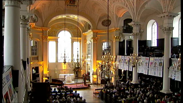 amnesty international celebrates 50th anniversary st martininthe fields int amnesty international symbol projected onto ceiling of church tilt down... - amnesty international stock videos & royalty-free footage