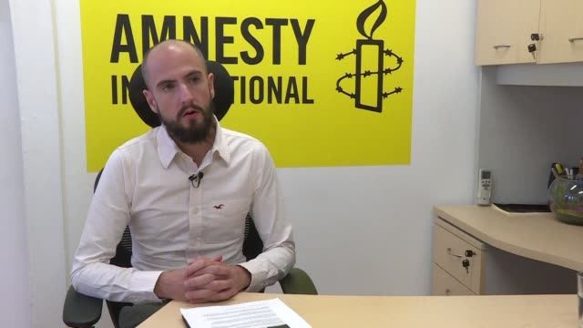 amnesty international discusses its new report on cuba in which it proposes integrating all the voices of cuban civil society and putting an end to... - amnesty international stock videos & royalty-free footage