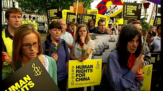amnesty international peaceful protest outside chinese embassy in london speaker addressing protesters sot various cutaway shots of protesters... - amnesty international stock videos & royalty-free footage