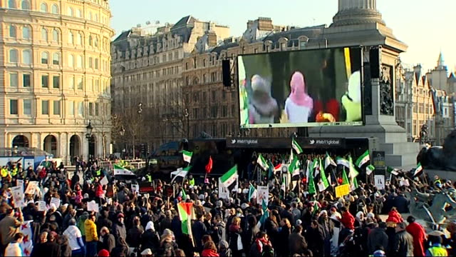 amnesty international rally in trafalgar square against continued violence in syria and wider region mid shots of protesters waving syrian flags /... - amnesty international stock videos & royalty-free footage