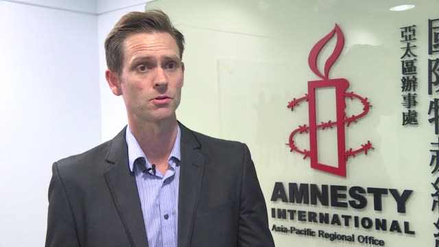 amnesty international says china wants to send a tough message to the international community with its ruling against a canadian drug suspect amid a... - amnesty international stock videos & royalty-free footage