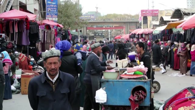 amnesty international says china's internment camps are trying to brainwash xinjiang's muslim minorities into obeying the communist party in... - xinjiang province stock videos & royalty-free footage