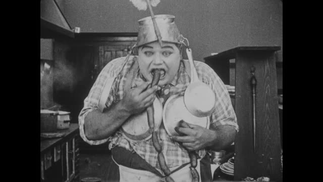 1918 amorous chef (fatty arbuckle) dances seductively with sausage links before eating - sausage stock videos and b-roll footage