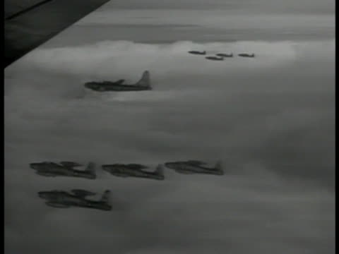 amp; thunderjets flying: aerial: xws b-50 superfortresses in flight wing fg. b-50's being escorted by f-84 thunderjets. b-50 over clouds 'city of... - former soviet union stock videos & royalty-free footage
