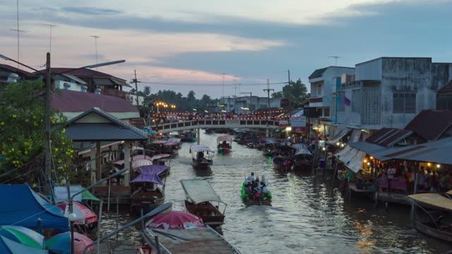 vídeos y material grabado en eventos de stock de mercado flotante de amphawa en tailandia - accesorio de cabeza