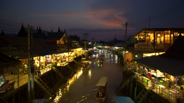 amphawa floating market in twilight time. - floating market stock videos & royalty-free footage