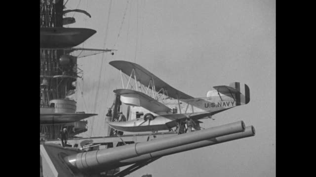 vídeos de stock, filmes e b-roll de cu amphibian plane / vs plane hoisted aboard catapult on battleship uss west virginia / vs from deck of plane on catapult above large cannons / pov... - baía de são francisco