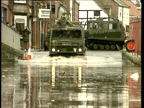 amphibious army vehicle drives through flooded street towards camera nov 00 - amphibious vehicle stock videos & royalty-free footage