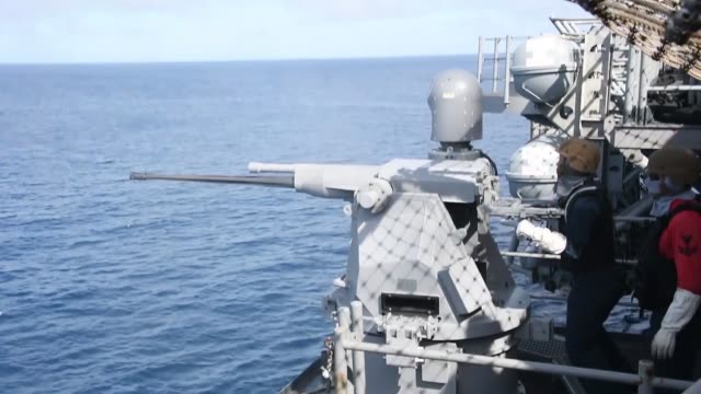 stockvideo's en b-roll-footage met amphibious assault ship uss boxer fires on a target craft during an integrated livefire exercise while conducting routine operations as a part of uss... - amerikaanse zeemacht