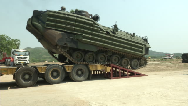 Amphibious assault vehicle is Loaded on trailer after USThai joint military exercise titled Cobra Gold on Hat Yao beach in Chonburi province eastern...