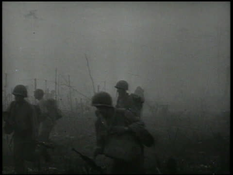 vídeos de stock e filmes b-roll de s amphibious tanks the 158th infantry regiment soldiers fighting through smoke fog advancing inland world war ii wwii pacific front new guinea... - veículo anfíbio