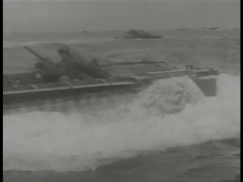 vídeos y material grabado en eventos de stock de amphibious tractors holding us marines moving on water. tarawa: explosions on island. aircraft in flight, out of frame, dropping bomb near building,... - vehículo anfibio