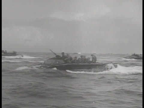 amphibious tractors holding us marines moving on water world war ii wwii - d day stock videos & royalty-free footage