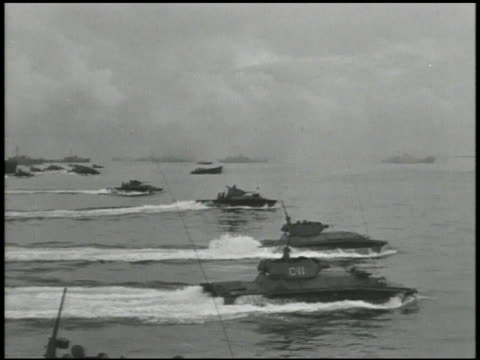 amphibious vehicles, amphibian tanks, landing vehicles moving toward smoking beach shore. soldiers, sailors, officers working in combat information... - amphibious vehicle stock videos & royalty-free footage