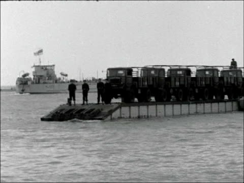 amphibious warfare demonstration; england: hampshire: nr portsmouth: eastney beach: ext amphibious army vehicle along from sea onto beach / soldiers... - amphibious vehicle stock videos & royalty-free footage