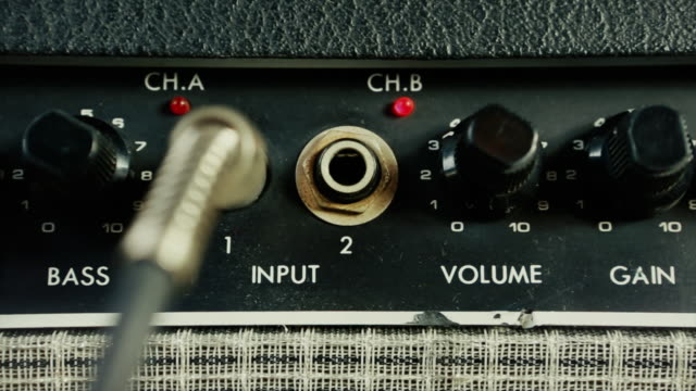 amplifier for electric guitar in a music studio - electrical plug stock videos & royalty-free footage